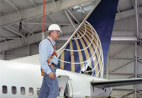 fall protection cable above an aircraft in a hangar