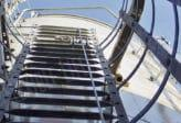 caged ladder and fall protection system on a tower