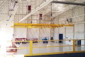 bridge fall protection system in an aircraft hangar