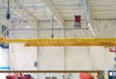 overhead rail fall protection in an aircraft hangar