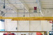 overhead rail fall protection in an aircraft hangar
