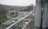 freestanding safety railing system on a roof
