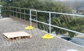 retrofitted freestanding safety rail on a roof